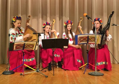 A Ukrainian-American folk ensemble sings and plays the bandura (a traditional Ukrainian instrument) for the Sebastopol community at SWF's annual Friendship Dinner